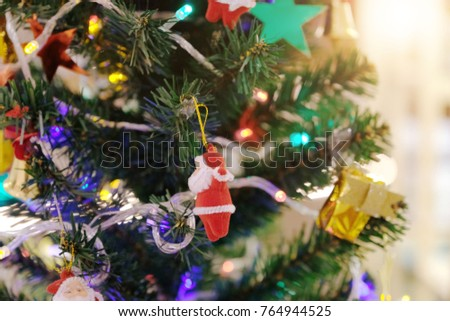 Christmas decorative with santa claus hanging from a decorated christmas tree  for background #764944525
