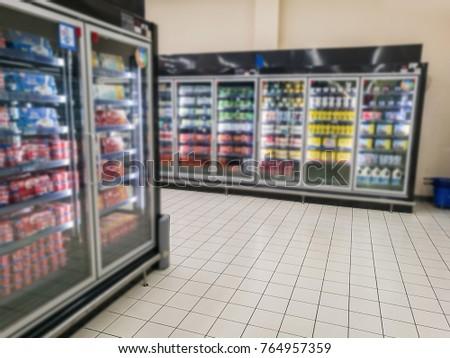 Supermarket shelves and shopping carts #764957359