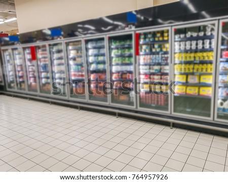 Supermarket shelves and shopping carts #764957926