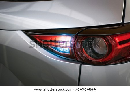 Car tail light red color for customers. Using wallpaper or background for transport and automotive image #764964844