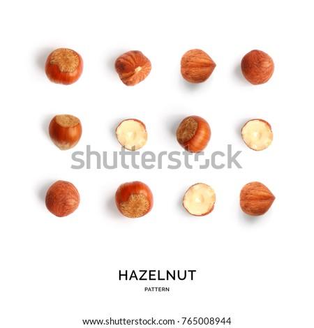 Seamless pattern with hazelnut. Abstract background. Hazelnut on the white background. #765008944
