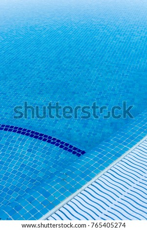 Blue tiles of a pool with overflow as a holiday background #765405274