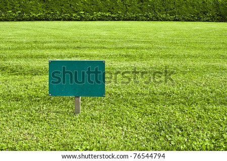 Green Keep of the grass blank sign in a meadow