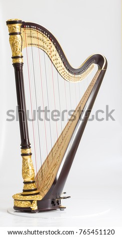 Classical music instrument. Pedal harp Royalty-Free Stock Photo #765451120