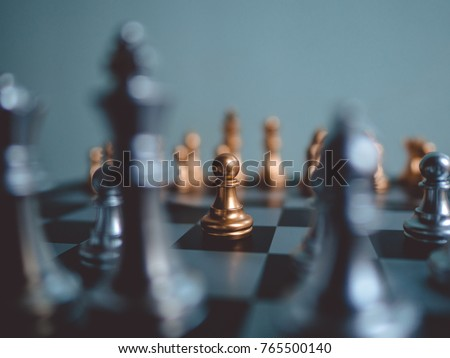 Chess game competition business concept ,  Fighting and confronting problems, threats from surrounding problems. Exhibited under the concept of games. Royalty-Free Stock Photo #765500140