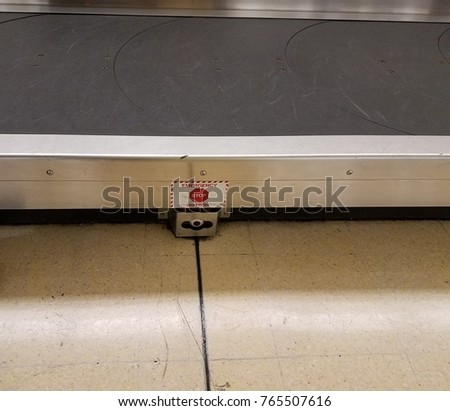 emergency stop button for luggage conveyor belt at airport #765507616