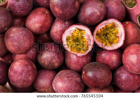 close up of fresh purple passion fruits harvest from farm Royalty-Free Stock Photo #765545104