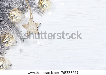 wooden star and silver christmas tree branch decorated with glowing light garland on white background #765588295