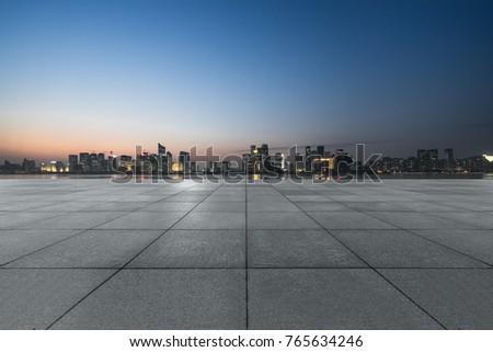 night view of empty brick floor front of modern building #765634246