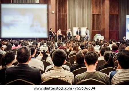 Abstract blurred photo of conference hall or seminar room with attendee background Royalty-Free Stock Photo #765636604