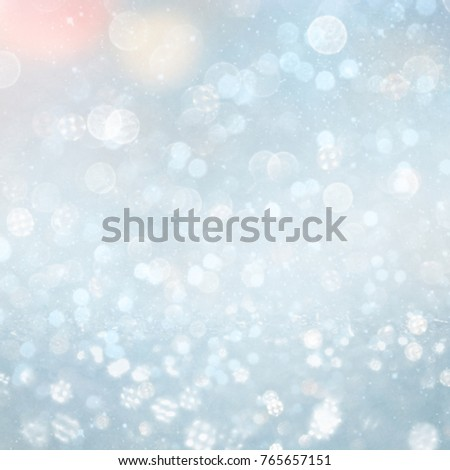 Blurred bokeh light background, Christmas and New Year holidays background #765657151