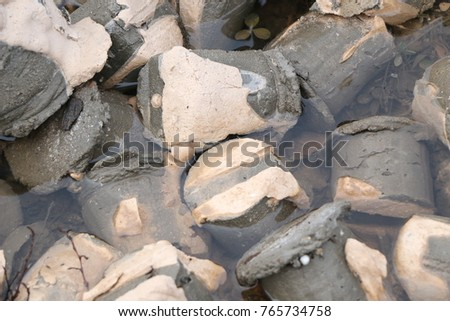 small concrete cylinders - scraps of concrete production in water and in paint #765734758