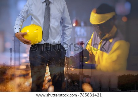 Engineer or Safety officer holding hard hat with construction site background . #765831421