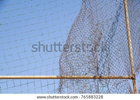 damage wire mesh steel on blue sky background #765883228