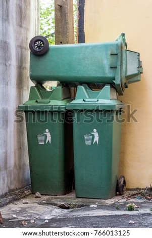 Large green wheelie bin stacked not in use. #766013125
