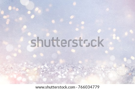 Blurred bokeh light background, Christmas and New Year holidays background #766034779