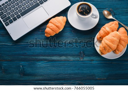 Business breakfast, coffee and croissants, on a wooden surface. Top view. Free space for text. #766055005