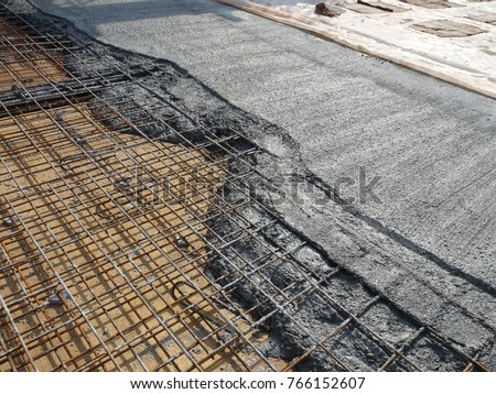 MALACCA, MALAYSIA -JULY 26, 2016: The wet concrete poured on a steel reinforcement bar to form strong floor slabs called reinforce concrete floor slab.  #766152607