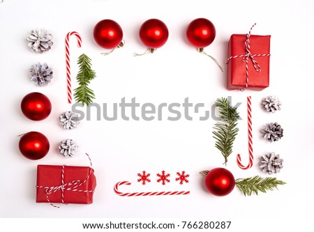 Christmas Frame from Christmas decorations and gifts on white background. Flat Lay. #766280287