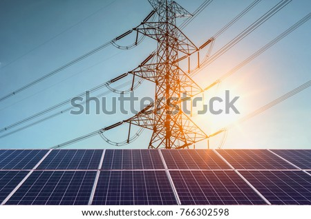 Solar panels with  electricity pylon and sunset. Clean power energy concept #766302598