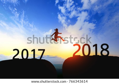 Woman jump through the gap between 2017 to 2018 on sunset. #766343614