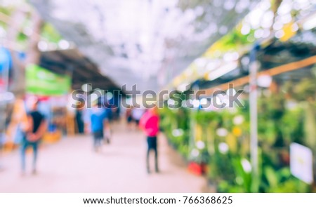 Abstract blur people in Outdoor gardening fair expo with bokeh for background usage . (vintage tone) #766368625