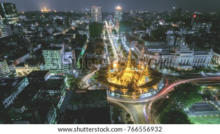Night scape Sule Pagoda centre of city in Yangon, Myanmar,Night Scape Sule Pagoda Center of city in Yangon, Myanmar,downtown,Sule,Pagoda,Myanmar,city,night,lights,modern,road,Cityscape,Landscap #766556932