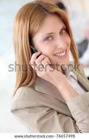 Portrait of beautiful businesswoman talking on mobile phone #76657498