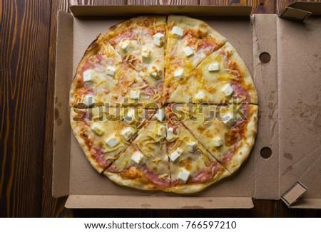 Pizza cut pieces lies in a box #766597210