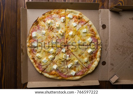Pizza cut pieces lies in a box #766597222