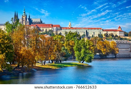 Old town of Prague, Czech Republic over river Vltava with Saint Vitus cathedral on skyline. Bright sunny day with blue sky. Praha panorama landscape view. #766612633
