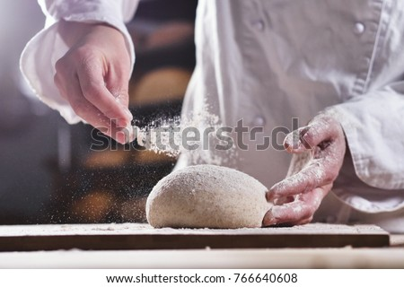 An experienced chef in a professional kitchen prepares the dough with flour to make the bio Italian pasta. the concept of nature, Italy, food, diet and bio. #766640608