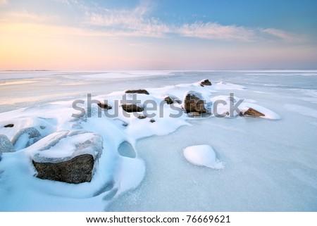 Stone on ice. Winter landscape. Royalty-Free Stock Photo #76669621