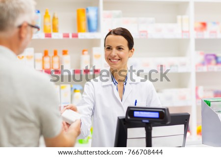 medicine, pharmaceutics, health care and people concept - apothecary and senior man customer buying drug at drugstore #766708444