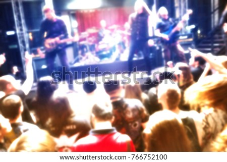 rock concert blurred background view from the audience,  rock musicians with guitars and vocalist #766752100