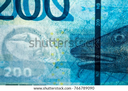 Obverse side of new Norwegian banknote series NOK 200 Kroner note, with a cod as primary motif. Watermark and security thread are visible when the note is held up to the light.