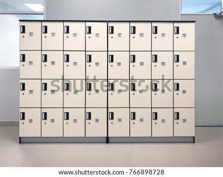 Lockers storage furniture in a locker room at school, gym or university. Royalty-Free Stock Photo #766898728
