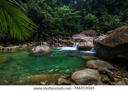 Beautiful river with lush green forest and various sizes of river stones in Terengganu, Malaysia. #766959049