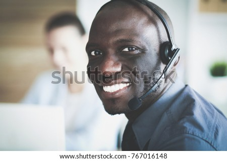 Portrait of an African American young business man with headset. #767016148