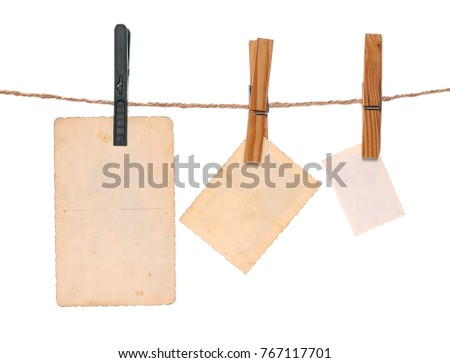 Old picture frame hanging on clothesline isolated on white background. #767117701