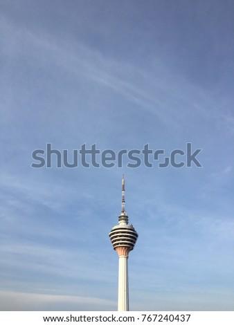 Kuala Lumpur, Malaysia - February 11, 2017: Kuala Lumpur tower with blue sky background #767240437