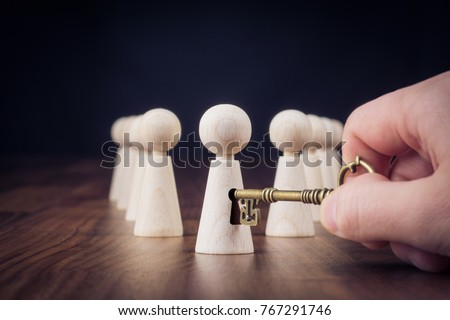 Unlock potential - motivational concept. Manager (HR specialist) unlock leader potential represented by figurine and hand with key. #767291746