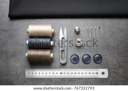 Accessories for tailoring on gray table #767322793