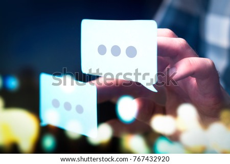 Communication, dialog, conversation on an online forum and internet chatting concept. Business man or social media consultant holding speech bubbles in futuristic modern abstract space. Royalty-Free Stock Photo #767432920