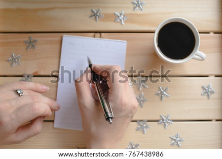 Woman writting a plan for coming year #767438986