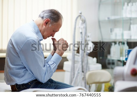 Sad mature man sitting in clinics after he got to know his diagnosis #767440555