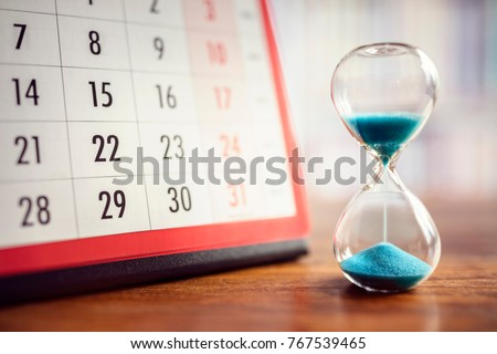 Hour glass and calendar concept for time slipping away for important appointment date, schedule and deadline #767539465