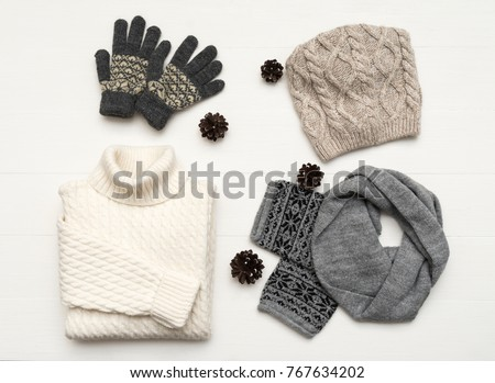 Beauty clothes arrangement with hat, mittens, sweater, scarf. flat lay, top view