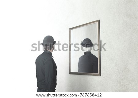 identity absence surreal concept; man in front of mirror reflecting himself without face #767658412
