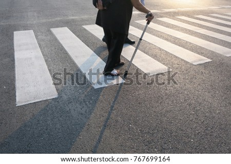 elderly person with walking stick #767699164